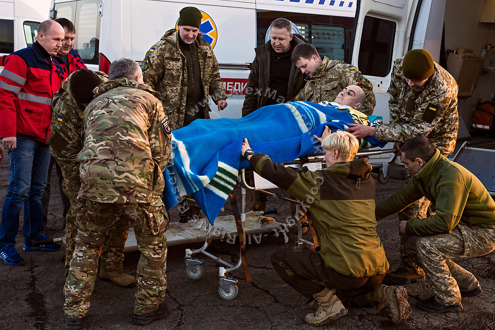 Members of ASAP are evacuating a soldier wounded by shrapnel to a helicopter in Bakhmut, a town in eastern Ukraine's conflict zone, carrying him to a better hospital in the city of Dnipropetrovsk.
