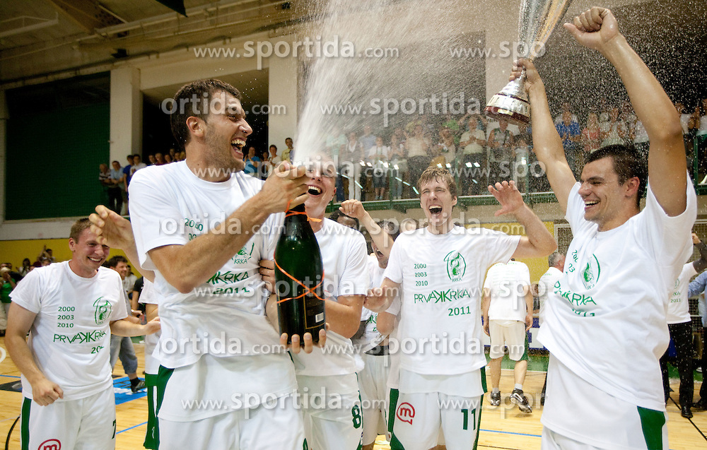 Smiljan Pavic, Edo Muric,  Zoran Dragic and Jure Balazic of Krka of Krka celebrate after the basketball match between KK Krka and Union Olimpija in 5th Round of Final of Slovenian National Championship, on June 11, 2011 in  Arena Leon Stukelj, Novo mesto, Slovenia. Krka defeated Union Olimpija 64-57 and became Slovenian National Champion 2011. (Photo By Vid Ponikvar / Sportida.com)