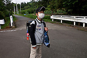 Minato Kanno (11) lives with his family in an area of Date with high radiation where residents were recommended to voluntarily evacuate. His family waits for a draw at the town hall where it will be decided if they will be of the first families which will be given houses in less contaminated areas of Date so that they can move. Until then he has to play indoors and when he goes to school he has to be fully covered, even though it is summer, while waiting for the school bus.