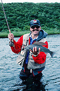 Alaska. Alaska Peninsula, Ugashik Narrows. A fisherman catches Arctic grayling. MR.
