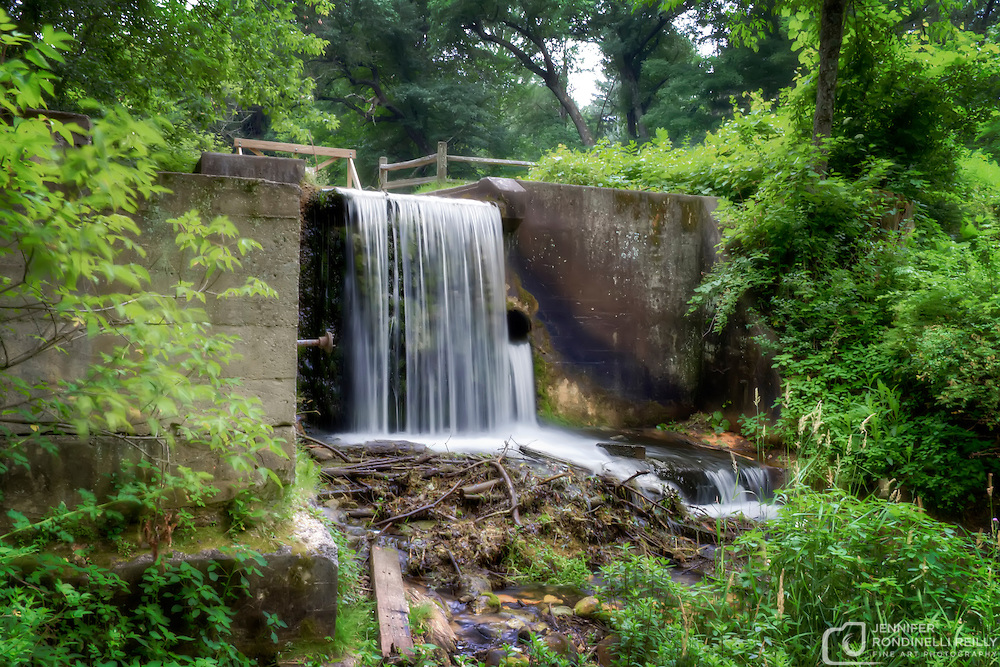Waterfall at Paradise Spring. Paradise Springs is located in Eagle, WI and the flat, aspahlt trail that leads to the abandoned spring house can be found in the southern part of the Kettle Moraine forest.