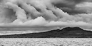 An unusual cloud formation over Rangitoto Island.  Rangitoto Island is a recent but extinct volcanic cone at the entrance of Auckland Harbour.