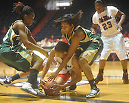 "Ole Miss Kenyotta Jenkins (11) and Southeastern Louisiana's Mary Fountain (33) and Gabrielle George (12) go for the ball at the C.M. ""Tad"" Smith Coliseum in Oxford, Miss. on Saturday, December 11, 2010."