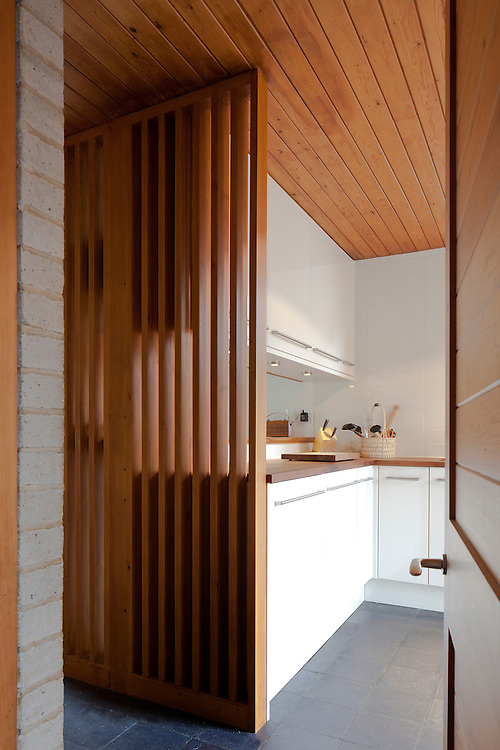 1960s modern kitchen interior with wooden divide
