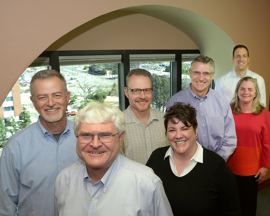 gbs030617i/BUSINESS -- Members of John Moore and Associates are, from left, David Stephens, John Moore, Dan Jameson, Ericka Bender, Joe Limke, Jami Schwalm and Brian Cochran. The Investment and Financial planning firm received an Ethics in Business award. (Greg Sorber/Albuquerque Journal)