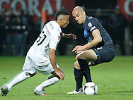 Portugal, FUNCHAL : Porto's brazilian defender Maicon (R) vies with Nacional's forward Marçal (L) during their Portuguese football match at Madeira Stadium in Funchal on March 16, 2012. .PHOTO/GREGORIO CUNHA.Estadio da Madeira, Funchal, Liga Portuguesa de futebol, Nacional vs Porto. .Marçal e Maicon.Foto Gregório Cunha