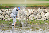 PALM BEACH GARDENS, FL - MARCH 06: Sergio Garcia from Spain hits out of a water hazard on the 5th hole during the second round of The Honda Classic at PGA National Resort and Spa on March 5, 2009 in Palm Beach Gardens, Florida.. (Photo by Rob Tringali) *** Local Caption *** Sergio Garcia