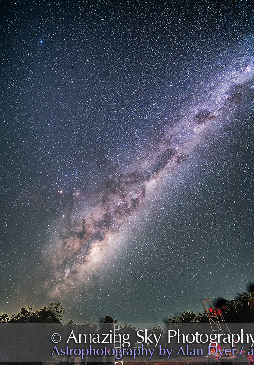 The galactic centre area of the Milky Way in Sagittarius and Scorpius rising over some of the telescopes of the OzSky Star Party, April 2016. The Milky Way extends up through Norma, Centaurus and into Carina and Crux. The Southern Cross is at top right. <br /> <br /> This is stack of 4 x 2.5-minute exposures tracked plus one 2.5-minute exposure untracked for the ground. All with the Rokinon 14mm lens at f/2.8 and Canon 5D MkII at ISO 4000.