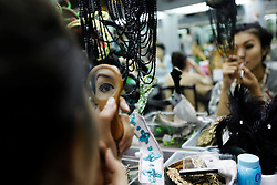 A performer puts on make-up in the backstage before the Tiffany Show in Pattaya, Thailand 08 April 2009. The Tiffany show is one of the biggest transvestite cabaret show in Thailand with about 80 to 100 performers performing three shows every night for the past 33 years. Pattaya, a tourist hotspot known as a sex and entertainment city will host the ASEAN plus three and six summits including leaders of China, Japan, South Korea, India, Australia, and New Zealand, with South East Asian leaders from 10 to 12 April.