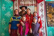 Family, Gypsy, traditional dress, living room, Romania