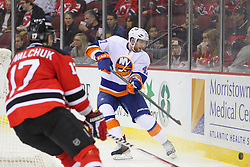 Jan 31, 2013; Newark, NJ, USA; New York Islanders defenseman Andrew MacDonald (47) plays the puck past New Jersey Devils right wing Ilya Kovalchuk (17) during the second period at the Prudential Center.