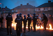 Riot police come under firebomb attack during disturbances in Bradford city centre. A planned march by The National Front in Bradford today was banned by the police but local Asians and groups of white men still clashed throughout the afternoon. Shops, pubs and cars were also damaged.