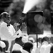 NEWPORT NEWS VA- SEPTEMBER 5: Participants in baptism by fire hose at the 84th Annual Holy Convocation In the State of Virginia at The United House of Prayer For All People, Newport News, VA on September 5, 2010. Bands played and people prayed, as hundreds of other members of the United House of Prayer for All People participate and are sprayed with a mist of water from a fire hose during a spiritual water baptism outside the church. The 84th annual mass water baptism that celebrates the end of the church's annual 'holy convocation' week (Photo by Logan Mock-Bunting).