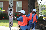 Youth Corps' D'Marius Deberry (foreground), Erika Sisk (right), and Dakota Hensley clean traffic signs in Oxford, Miss. on Tuesday, June 25, 2013.