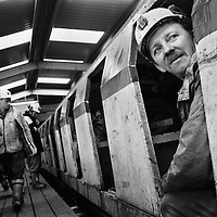 MINERS GETTING ON THE TROLLEY TRAIN TO BEGIN THEIR TEN HOURS SHIFT UNDERGROUND AT LONGANNET COLLIERY, CULROSS. SCOTLAND, APRIL, 2001.