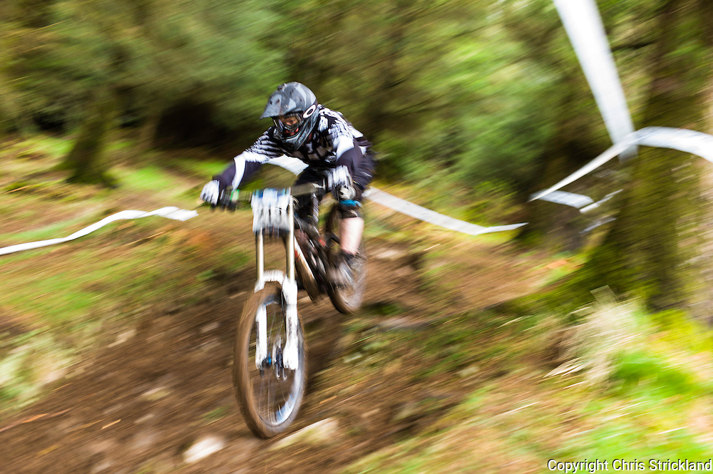 Ae Forest, Dumfries, Scotland, UK. 25th April 2015. Downhill Mountain Biker Christian Hodgson takes on the 7Stanes course at Ae during the Scottish Downhill Association racing.