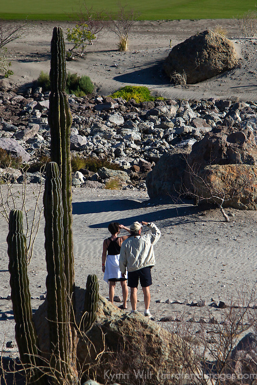 Mexico, Baja California Sur, Loreto. Couple at Villa del Palmar Loreto golf resort and spa.