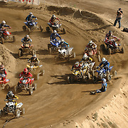 The fifth picture of the sequence of a crash at the ATVA MX National Feb 4-5, 2006 at Glen Helen. The fifth picture displays Jerimiah Jones (#2)sitting up looking for his bike. As his bike collects (#16) Jeremy Lawson on the left.  Doug Gust (#55) again seems to navigate through, as Farr (#4) gets back in control but leave Dustin Wimmer (#191) with no where to go. In the middle of the pack Travis Spader (#30) and (#94) Nelson get together as Nelson is starts to get sideways.