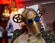 One of the many Las Vegas Steampunk Guild members costumed during First Friday activities as they present a Steampunk Wonderland art competition on Friday, August 1, 2014.  L.E. Baskow