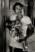 A mother feeds her baby in a village on Lembata Island, Indonesia.
