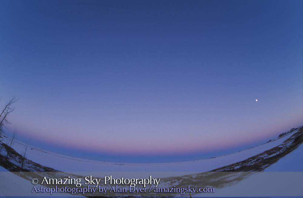 Earth's shadow, looking east, at sunset, with pink Belt of Venus above dark blue shadow. Gibbous Moon above that in SE.<br /> <br /> Taken with 16mm full-frame fish-eye lens