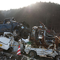 Cars destroyed by the 2011 tsunami sit piled in an enclosure, on the 1 year anniversary of the March 11th 2011 earthquake and tsunami, in Minami-Sanriku, Tohoku region, Japan on Sunday 11th March 2012.