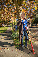 """Russian immigrant Liubov Hattaway rakes leaves in front of her home in Calistoga.  """"I want make all people friendly...like people of Calistoga."""""""
