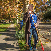 "Russian immigrant Liubov Hattaway rakes leaves in front of her home in Calistoga.  ""I want make all people friendly...like people of Calistoga."""