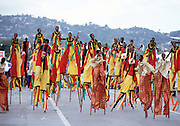"Trinidad and Tobago ""MOKO JUMBIES: The Dancing Spirits of Trinidad"".(Moko Jumbies, in full regalia, storm the stage at Queens Park Savannah as a section of the Legends band, who won the title Band Of The Year several times.).A photo essay about a stilt walking school in Cocorite, Trinidad..Dragon Glen de Souza founded the Keylemanjahro School of Art & Culture in 1986. The main purpose of the school is to keep children off the streets and away from drugs..He first taught dances like the Calypso, African dance and the jig with his former partner Cathy Ann Samuel.  Searching for other activities to engage the children in, he rediscovered the art of stilt-walking, a tradition known in West Africa as the Moko Jumbies , protectors of the villages and participants in religious ceremonies. The art was brought to Trinidad by the slave trade and soon forgotten..Today Dragon's school has over 100 members from age 4 and up..His 2 year old son Mutawakkil is probably the youngest Moko Jumbie ever. The stilts are made by Dragon and his students and can be as high as 12-15 feet. The children show their artistic talents mostly at the annual Carnival, which today is unthinkable without the presence of the Moko Jumbies. A band can have up to 80 children on stilts and they have won many of the prestigious prizes and trophies that are awarded by the National Carnival Commission. Designers like  Peter Minshall , Brian Mac Farlane and Laura Anderson Barbata create dazzling costumes for the school which are admired by thousands of  spectators. Besides stilt-walking the children learn the limbo dance, drumming, fire blowing and how to ride  unicycles..The school is situated in Cocorite, a suburb of Port of Spain, the capital of Trinidad and Tobago..all images © Stefan Falke"