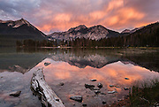 Sunrise light illuminates virga clouds over Pettit Lake, near Stanley, Idaho, in Sawtooth National Recreation Area, USA. The Sawtooth Range (part of the Rocky Mountains) are made of pink granite of the 50 million year old Sawtooth batholith. Sawtooth Wilderness, managed by the US Forest Service within Sawtooth National Recreation Area, has some of the best air quality in the lower 48 states (says the US EPA).