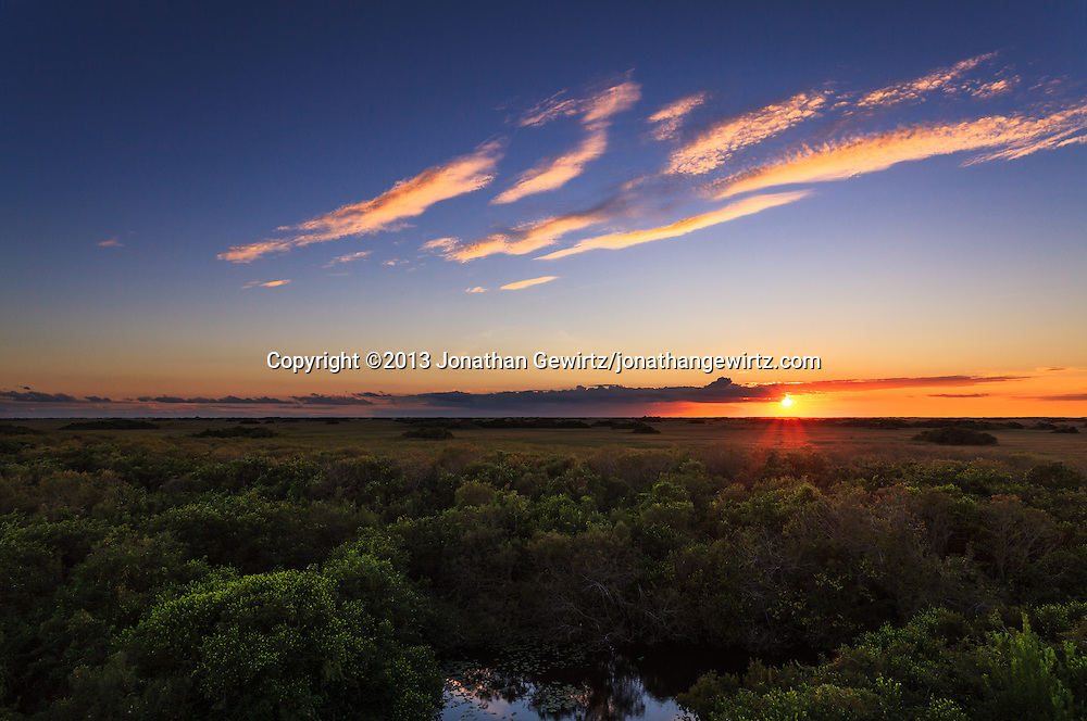 A beautiful sunset in the Shark Valley section of Everglades National Park, Florida. WATERMARKS WILL NOT APPEAR ON PRINTS OR LICENSED IMAGES.