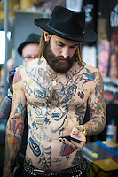 @Licensed to London News Pictures 24/05/15. London, UK. Tattoo artists attending the Great British Tattoo Show at Alexandra Palace today in north London, UK.Photo credit: Manu Palomeque/LNP