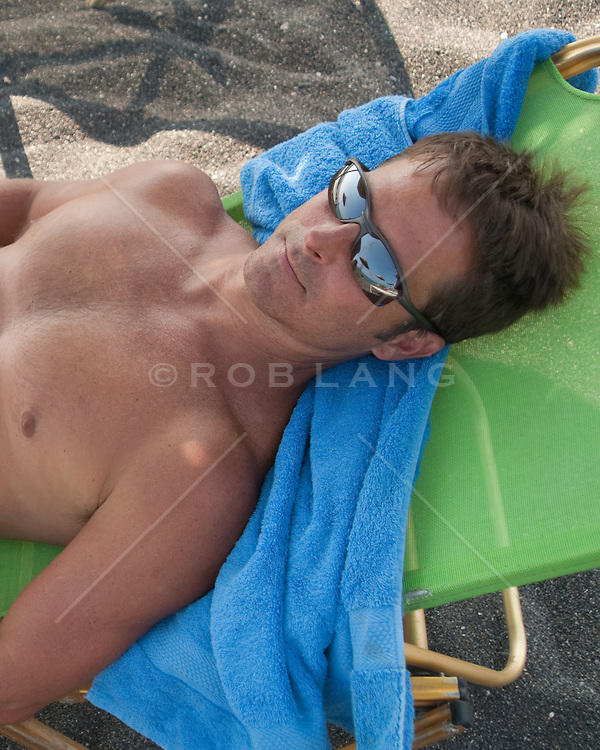 man relaxing in a beach chair