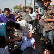A wounded Egyptian activist is attended to by paramedics at a field medical station set up by protesters during May 4, 2012 demonstrations against the ruling Supreme Council of the Armed Forces (SCAF) near the Defense ministry building in the Abbasiya district of Cairo. Close to 300 people were injured in the clashes, one killed, and an estimated 300 people arrested by the military.