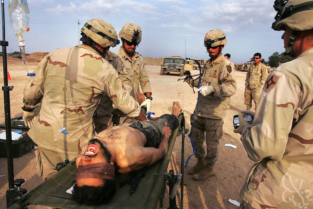 A wounded Jordanian jihadist fighter is treated by medics from the U.S. Army 1st Infantry Division 2-2 Task Force in Fallujah,Iraq November 14, 2004. The foreign fighter was wounded along with 2 other foreign fighters and one Iraqi while battling U.S. and Iraqi forces who have retaken the insurgent stronghold city of Fallujah.