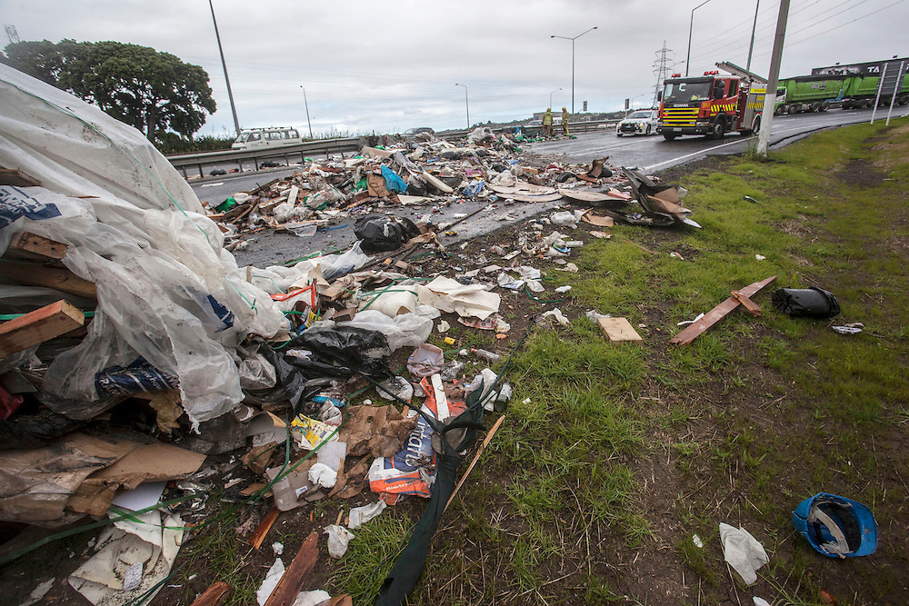 Emergency workers at the scene of a rubbish truck trailer crash on the Nielson Street motorway on-ramp at Onehunga, Auckland, New Zealand, Tuesday, October 29, 2013. A fire appliance came across the incident on the way to another emergency and couldn't proceed.SNPA / Bradley Ambrose