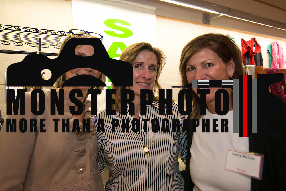 LEFT TO RIGHT: Janet Jornlin, Deirdre Pettinaro and Patty McCoy pose for a photo during the 3rd Annual Guilty Girls Warehouse Sale Friday, Feb. 06, 2015 at University of Delaware's Arsht Hall in Wilmington, DE.