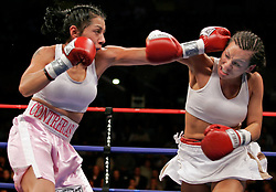 Noriko Kariya (r), sister of NHLer's Paul and Steve Kariya, and Maria Lucy Contreras (l) trade punches during their 6 round featherweight bout.  With the win, Kariya remained undefeated and moved her record to 4-0.  The bout took place on the undercard of the Arturo Gatti vs Thomas Damgaard IBA Welterweight Championship bout at Boardwalk Hall in Atlantic City, NJ.