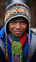 Portrait of a Nepali boy wearing a colourful hat and scarf, Nepal