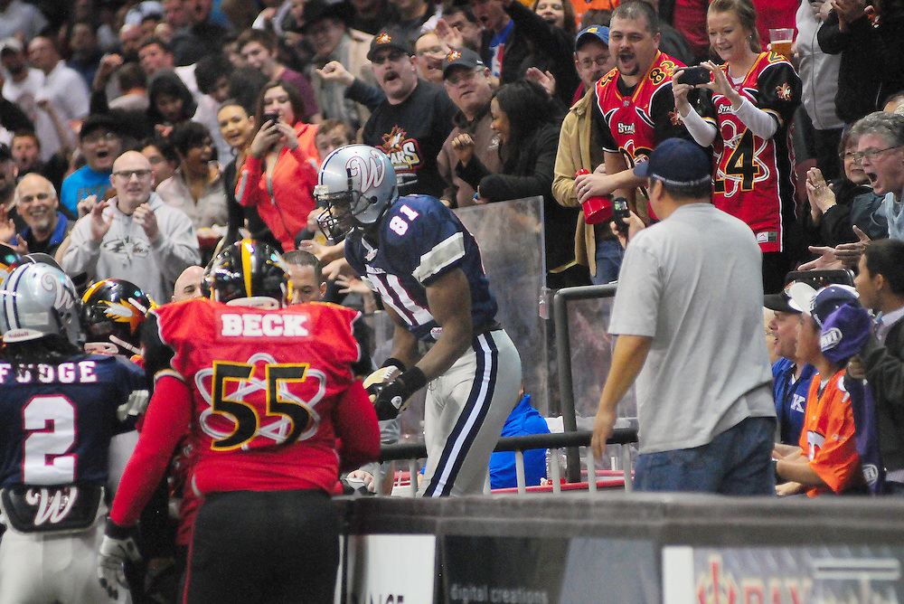 apl031112c/SPORTS/Adolphe Pierre-Louis/Albuquerque Journal/031112.The crowd reacts as former NFL and current Allen Wrangler  wide receiver Terrell Owens,,is pushed into the stands  during half time of the game against New Mexico Stars on Sunday March 11, 2012 .