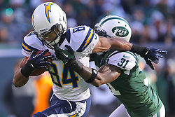 Dec 23, 2012; East Rutherford, NJ, USA; San Diego Chargers wide receiver Danario Alexander (84) is tackled by New York Jets cornerback Antonio Cromartie (31) during the first half at MetLIfe Stadium.