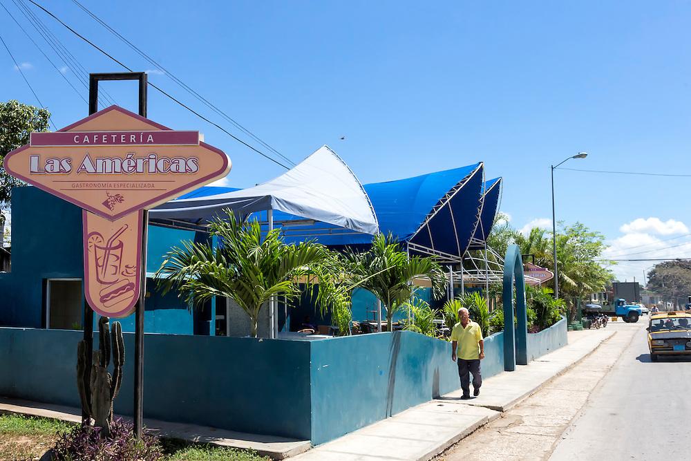 Cafe and street in Bayamo, Granma, Cuba.