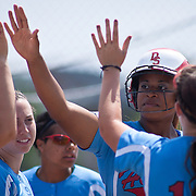 04/21/12 Dover Del. Delaware State Bria Green high fives her teammates after scoring in the first inning of a NCAA Softball game against Norfolk State Saturday, April. 21, 2012 at The Hornets Nest in Dover Del.<br /> <br /> Delaware State defeated Norfolk State 10-0 Saturday afternoon.<br /> <br /> Special to The News Journal/SAQUAN STIMPSON