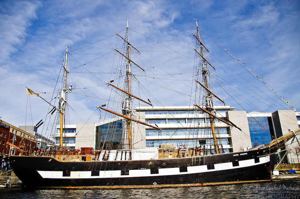 """The Jeanie Johnston is a replica """"famine ship"""" docked at Custom House Quay on the Liffey River in Dublin, Ireland."""