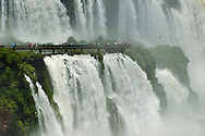 Iguacu Falls with tourists on walkway, Iguacu National Park, Brazil
