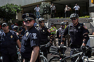 Police keep watch over the March on Wall Street South protest on Sunday, September 2, 2012 in Charlotte, NC.