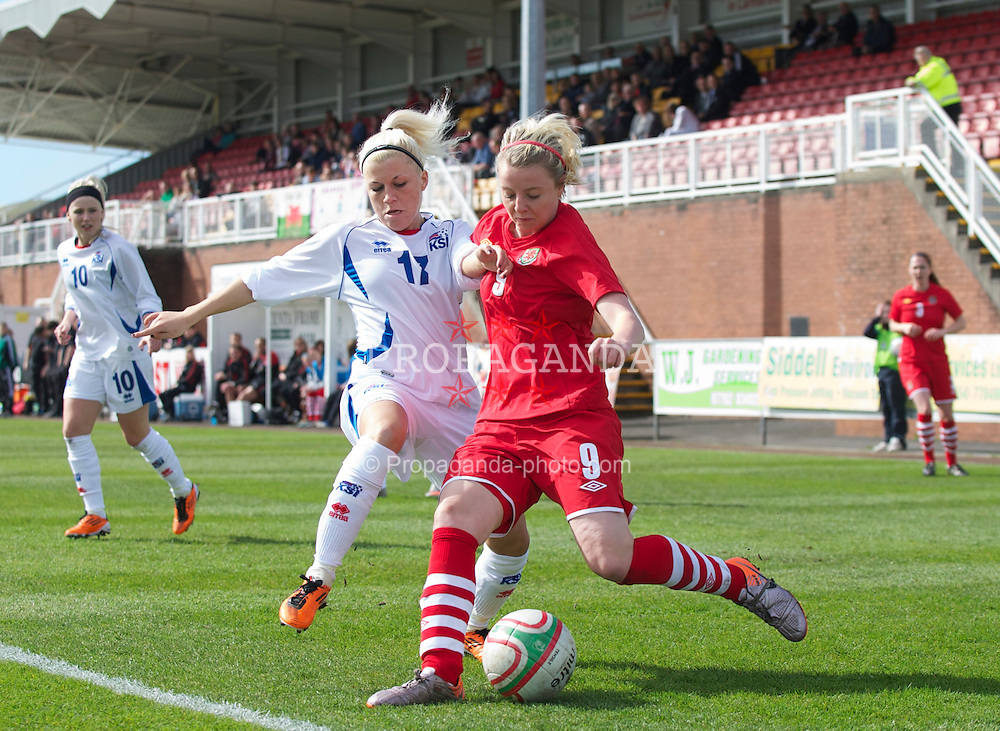 LLANELLI, WALES - Saturday, April 2, 2011: Wales' Hannah Keryakopolis and Iceland's Fjolla Shala during the UEFA European Women's Under-19 Championship Second Qualifying Round (Group 3) match at Stebonheath Park. (Photo by David Rawcliffe/Propaganda)