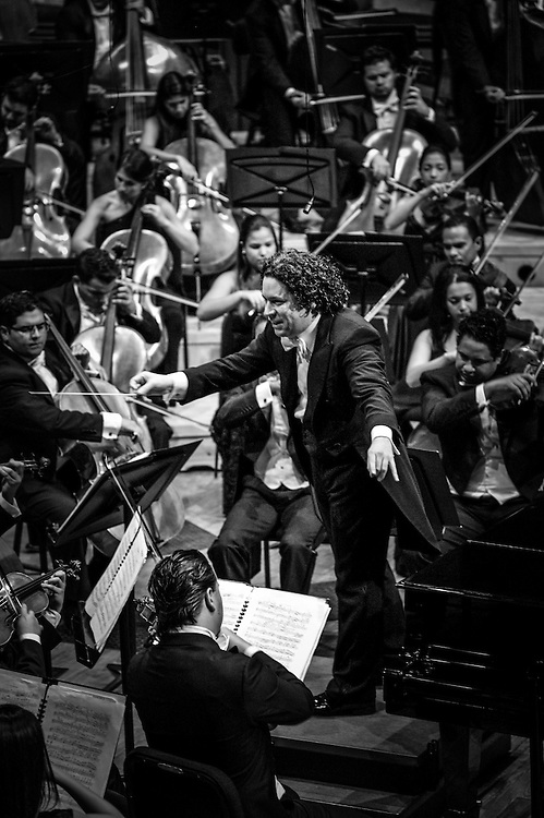 Gustavo Dudamel conducts a performance of the Simon Bolivar Orchestra in Caracas, Venezuela. Dudamel was trained by the El Sistema program, and is widely regarded as it's most accomplished alumni.  He is now the conductor of the Los Angeles Philharmonic Orchestra.