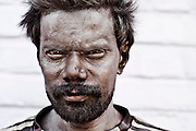 A worker's face  smeared with harmful sticky chemicals used to manufacture fireworks.These chemicals sticks to their hands permanently after working in factories for years and causes health issues. Image © Balaji Maheshwar/Falcon Photo Agency