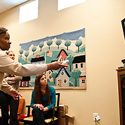 Caroline Flint, OT 13, (right) cheers as Edith Wright plays Wii bowling at The Buddy Coholan Center in Medford. (Alonso Nichols/Tufts University)